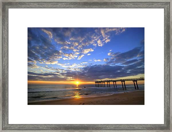 Sunrise Surfers Framed Print