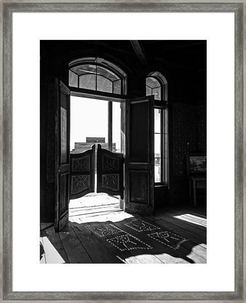 Swinging Doors Framed Print