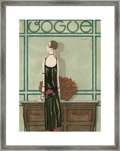 Vogue Magazine Cover Featuring A Woman Wearing Framed Print by Georges Lepape