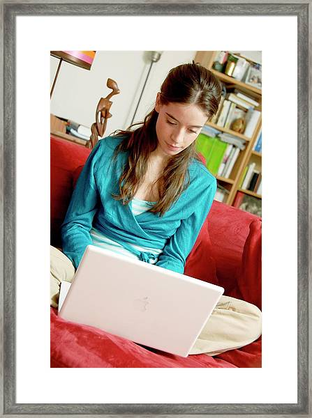Woman Using A Laptop Computer Framed Print by Aj Photo/science Photo Library