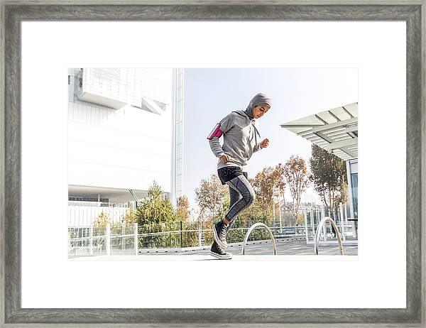 Young Muslim Woman Ready To Running In The City Framed Print by LeoPatrizi