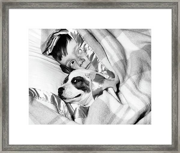 1950s Boy Hiding Under Blanket In Bed Framed Print