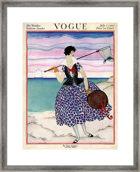 A Vogue Magazine Cover Of A Woman Framed Print