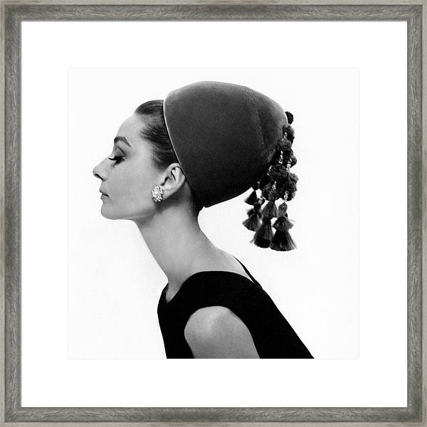 Audrey Hepburn Wearing A Givenchy Hat Framed Print by Cecil Beaton