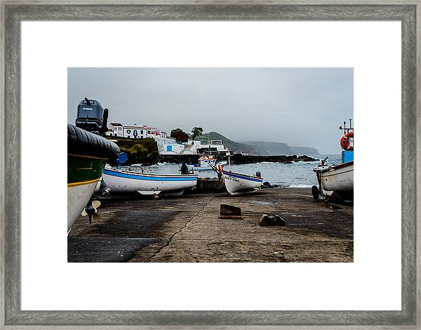 Fishing Boats On Wharf With View Of Houses  Framed Print