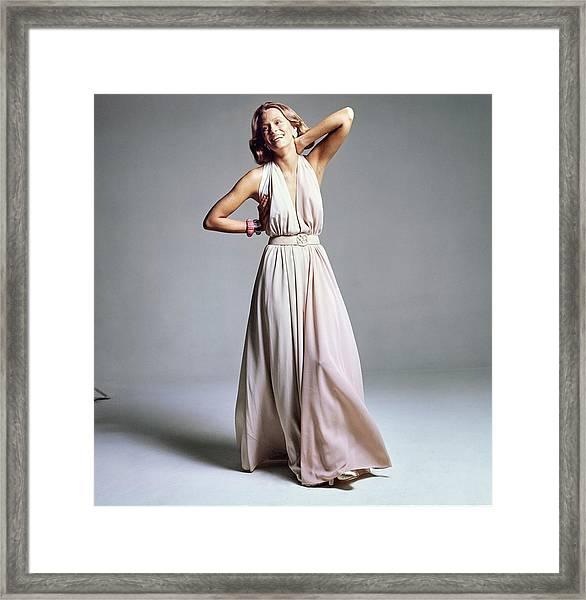 Lauren Hutton Wearing A Galanos Dress Framed Print by Bert Stern