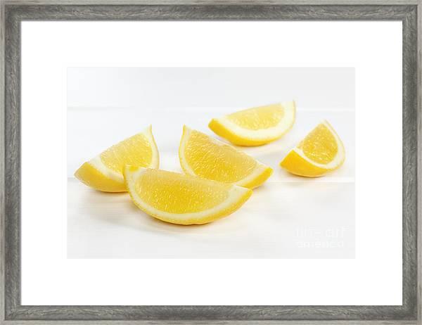 Lemon Wedges On White Background Framed Print