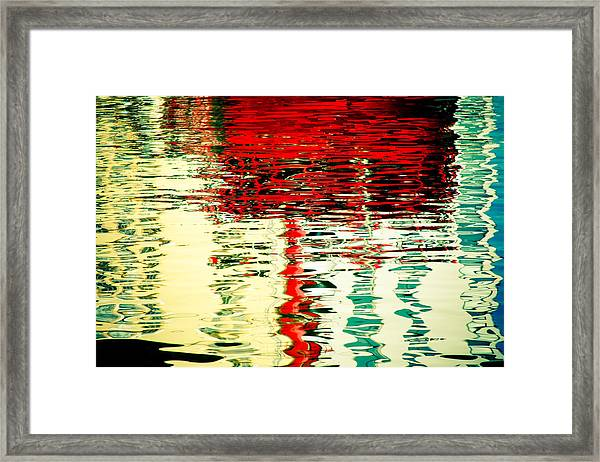Reflection In Water Of Red Boat Framed Print