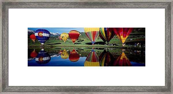 Reflection Of Hot Air Balloons Framed Print