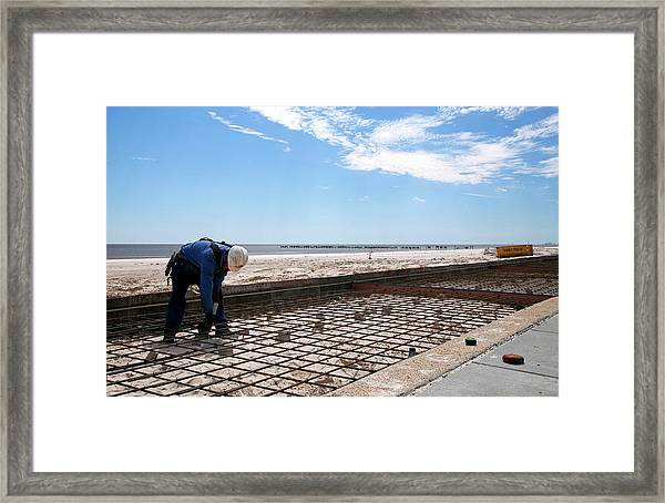 Repairing Hurricane Katrina Damage Framed Print by Jim West