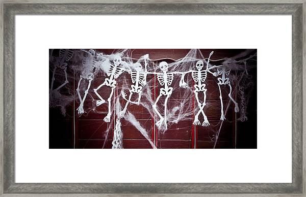 Skeletons Framed Print