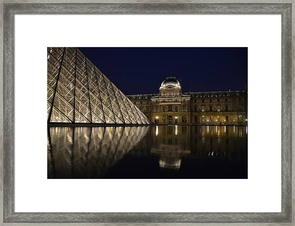 The Louvre Palace And The Pyramid At Night Framed Print