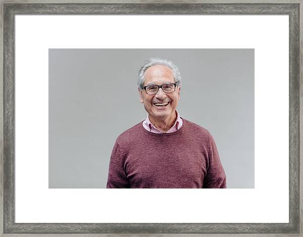 Portrait Of A Smiling Senior Business Man Framed Print by Serts