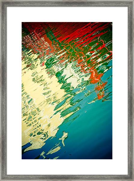 Framed Print featuring the photograph Reflection In Water Of Red Boat by Raimond Klavins