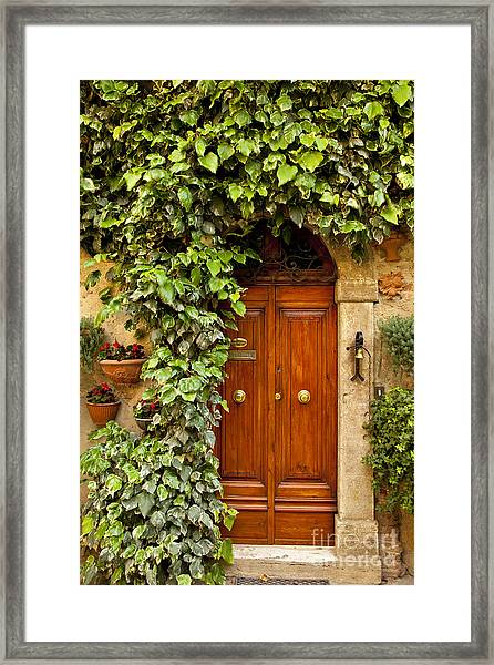 Framed Print featuring the photograph Tuscan Door by Brian Jannsen