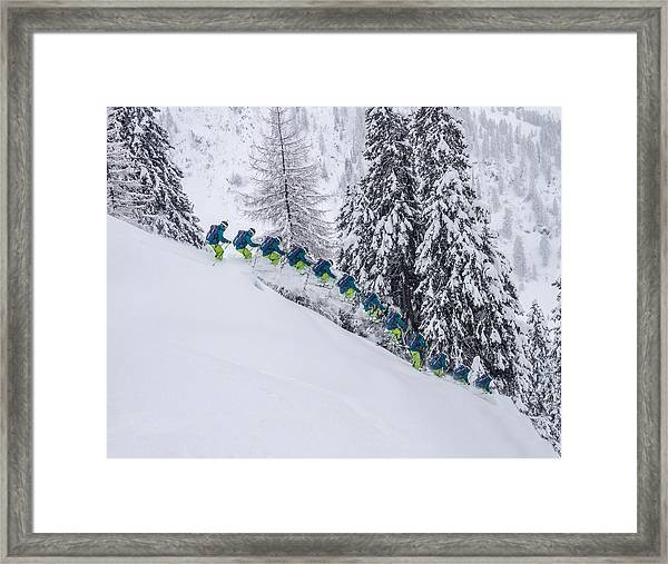 Young Male Freerider Skiing Down A Powder Slope Framed Print by Leander Nardin