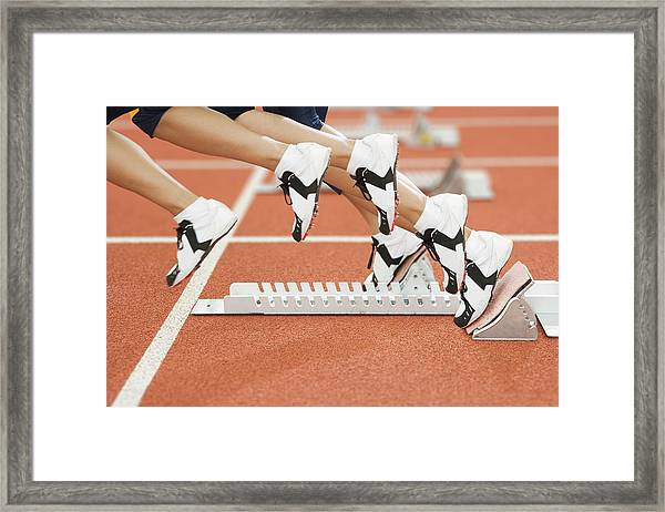 Athlete Leaving The Blocks Framed Print by Gustoimages/science Photo Library