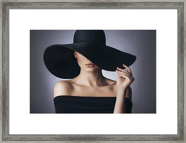 Studio Shot Of Young Beautiful Woman Framed Print by CoffeeAndMilk