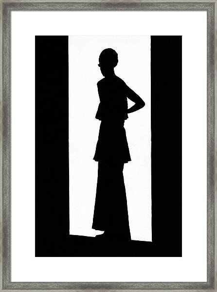 The Silhouette Of A Woman Framed Print