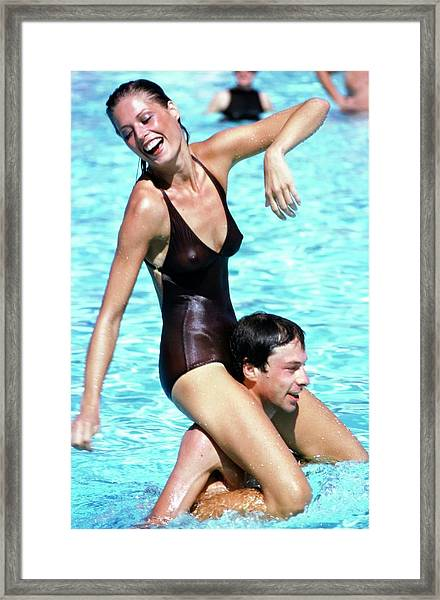 Model Wearing A Catalina Swimsuit Framed Print by Arthur Elgort