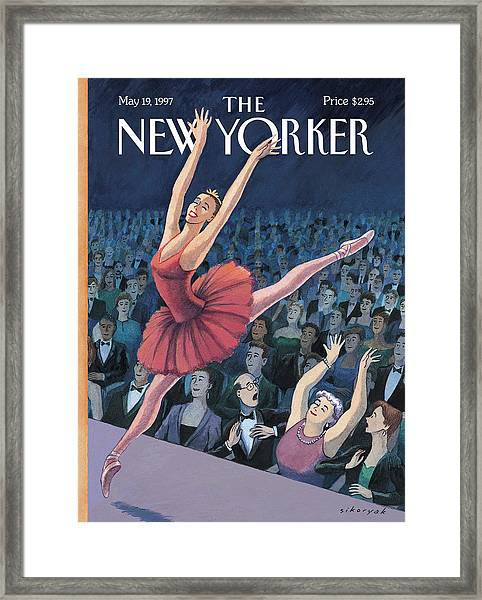 A Ballerina Performs In Front Of An Audience Framed Print