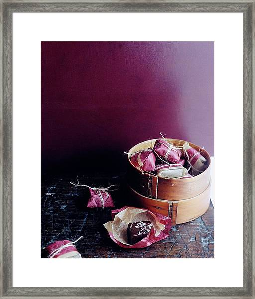 A Bamboo Steamer With Paper Packages Framed Print