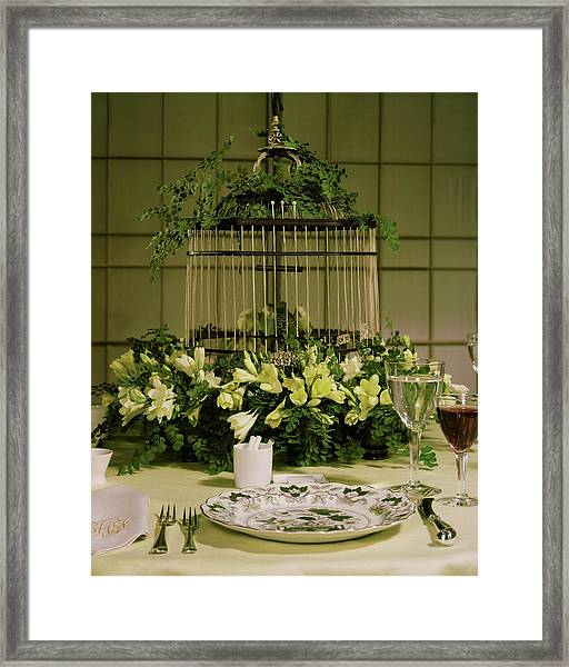 A Birdcage In The Middle Of A Table Framed Print