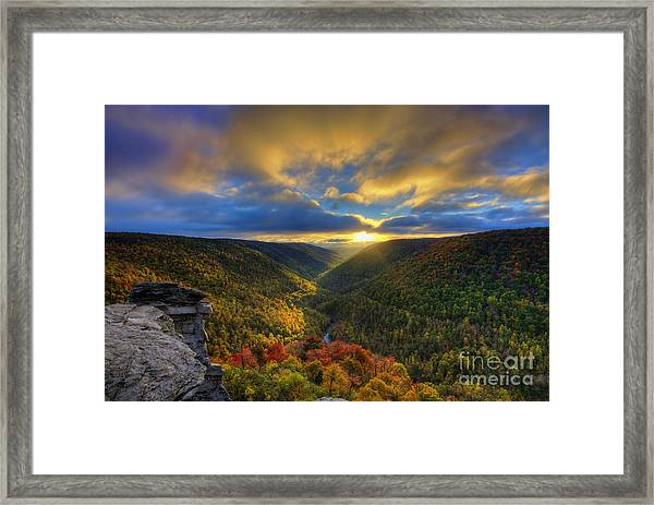A Blue And Gold Sunset Framed Print