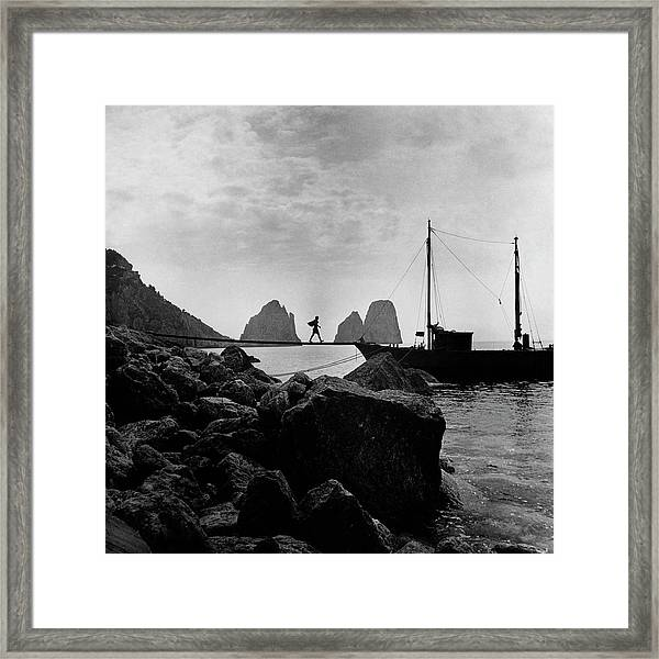 A Boat Docked At Capri Framed Print