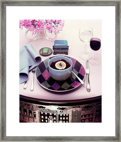 A Bowl Of Food On A Pink Table Framed Print