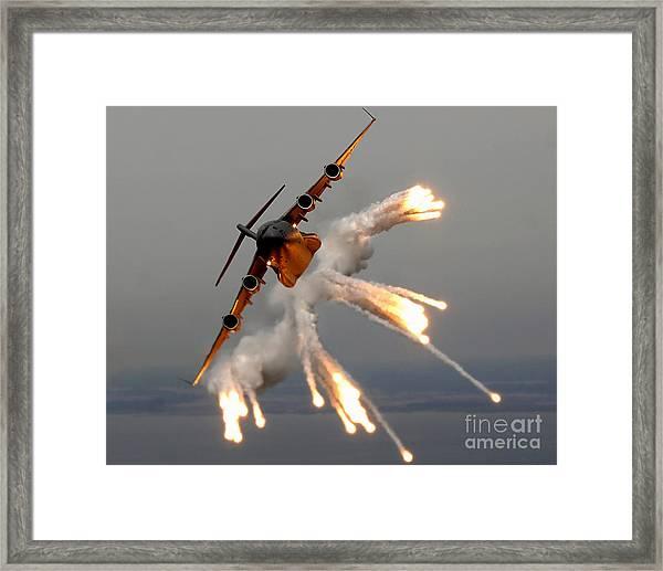 A C-17 Globemaster IIi Releases Flares Framed Print