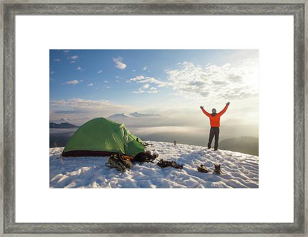 A Camper Lifts His Hand In The Air Framed Print
