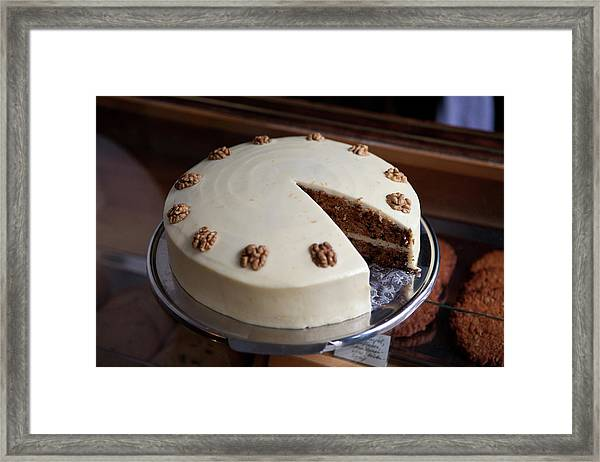 A Carrot Cake On A Display Cabinet In A Framed Print