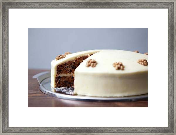 A Carrot Cake With A Slice Missing For Framed Print