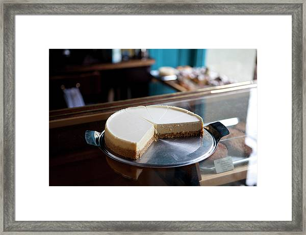 A Cheesecake Cut Into Slices On A Framed Print