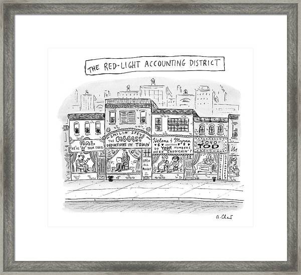 A City Block Is Full Of Buildings With Glass Framed Print