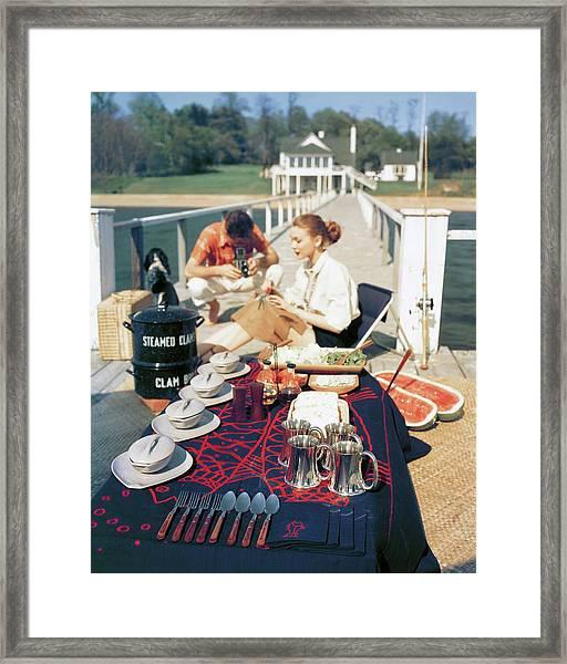 A Clam Bake On A Pier Framed Print by John Rawlings