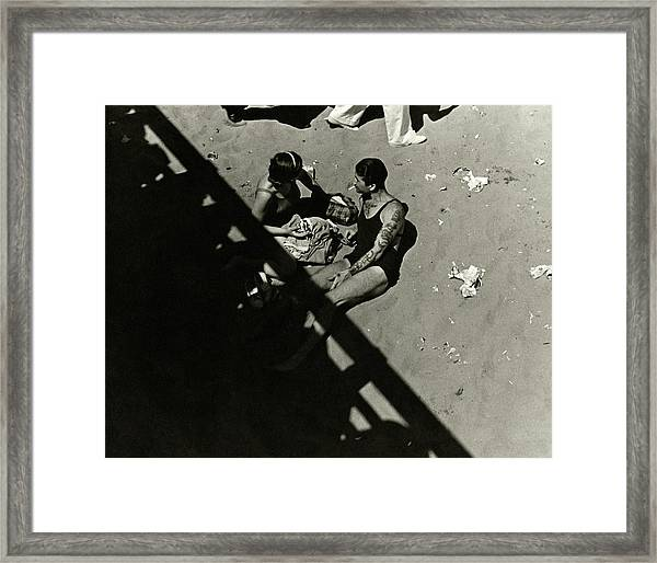 A Couple At Coney Island Framed Print