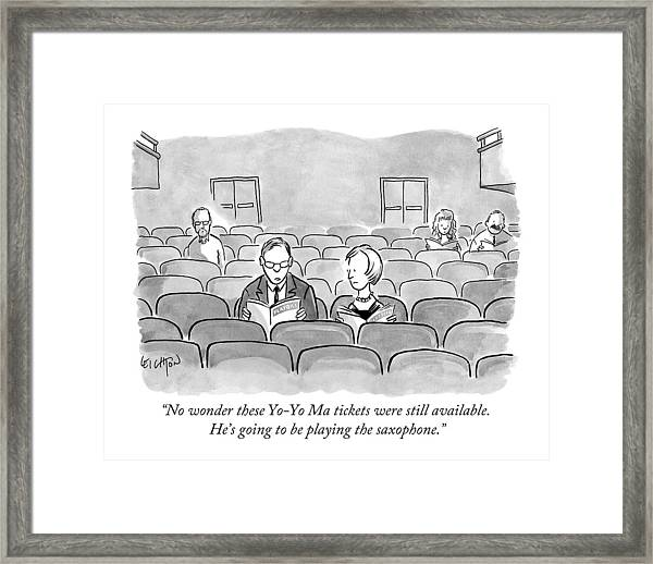 A Couple Sits Reading A Playbill Framed Print
