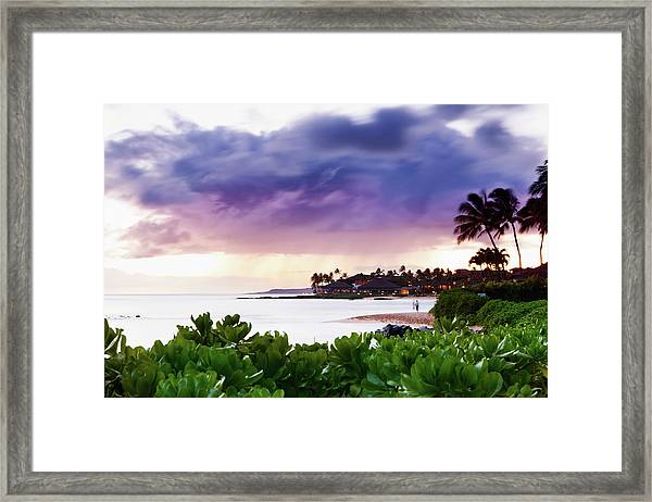 A Couple Watches The Sunset From The Framed Print
