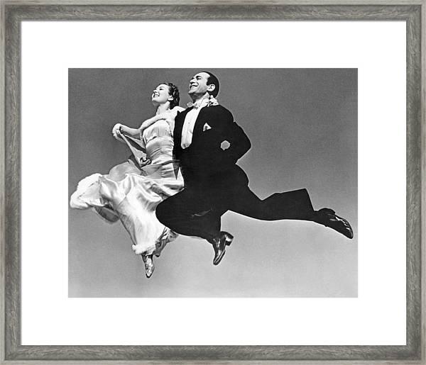 A Dance Team Does The Rhumba Framed Print