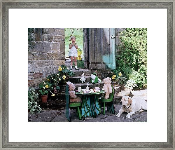 A Dog Sitting Next To Two Teddy Bears Having Framed Print