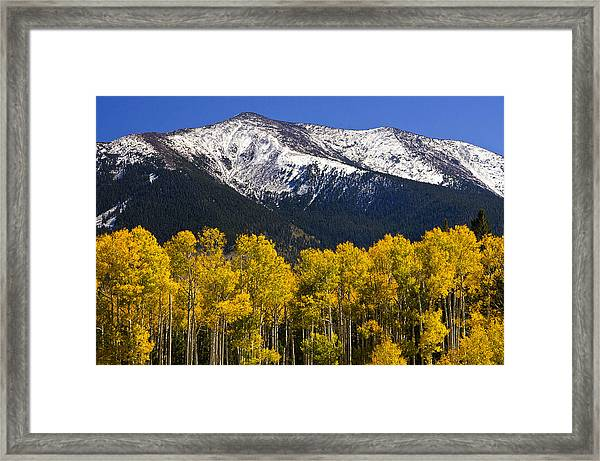 A Dusting Of Snow On The Peaks Framed Print