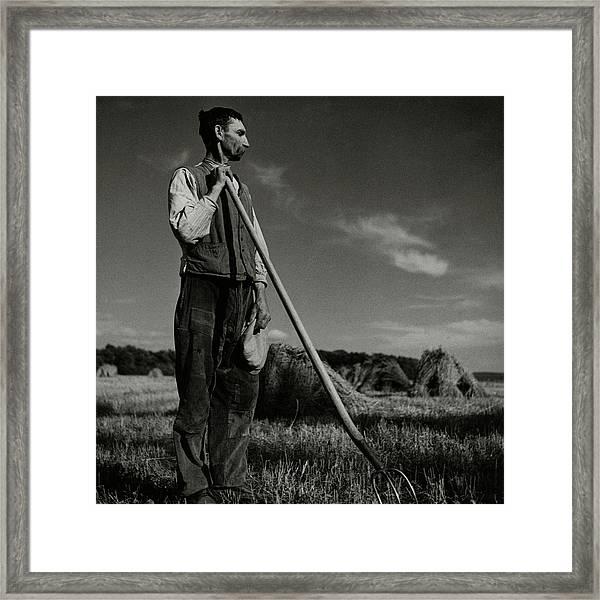 A Farmer Holding A Pitchfork Framed Print