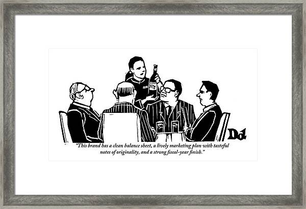 A Female Sommelier Presents A Bottle Of Wine Framed Print