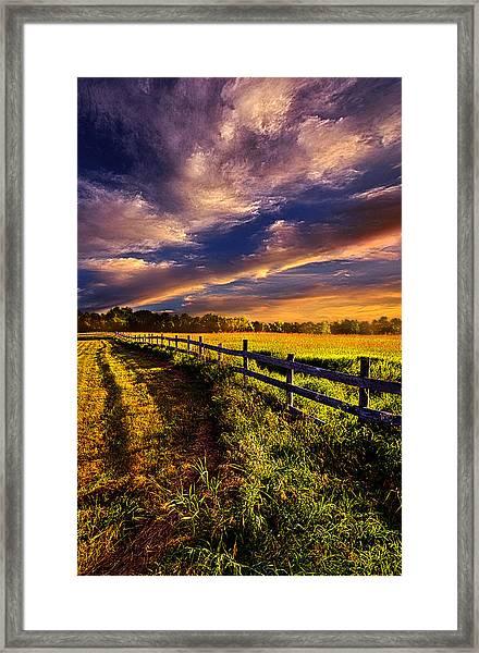 A Fence Runs Through It Framed Print