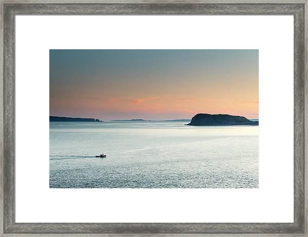 A Fishing Boat Cruises Through Flat Framed Print