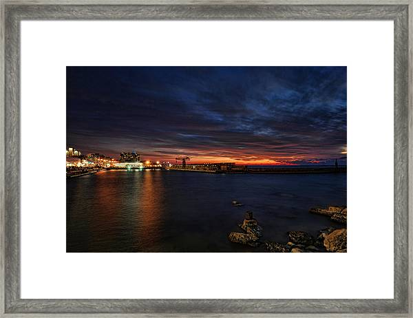a flaming sunset at Tel Aviv port Framed Print
