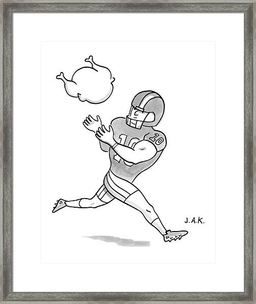 A Football Player Poises To Catch A Turkey Framed Print