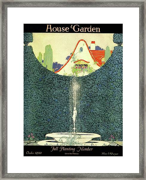 A Fountain With A Hedge In The Background Framed Print